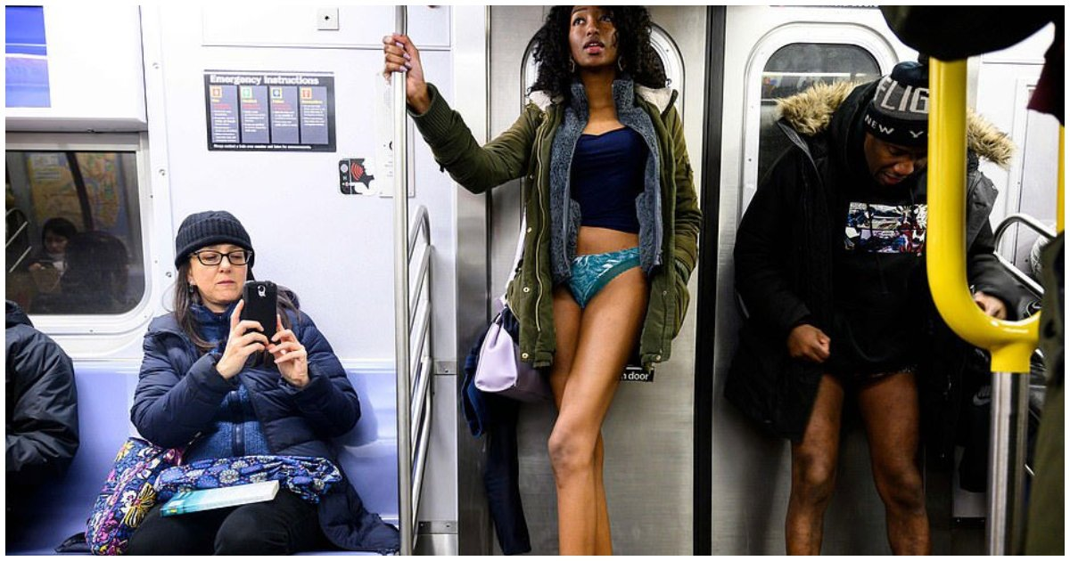 "no pants.jpg?resize=412,232 - This Is Crazy! Passengers Take Off Their Trousers As Part Of The 10th Annual ""No Trousers On The Tube Day"""