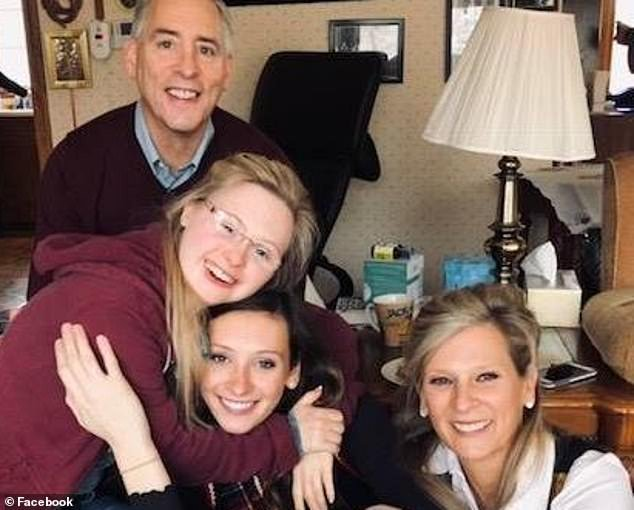 Supportive: Linda (right) and Jeff (top left) were also told that their daughter Grace, pictured with younger sister Laine (center), would never learn to read or write