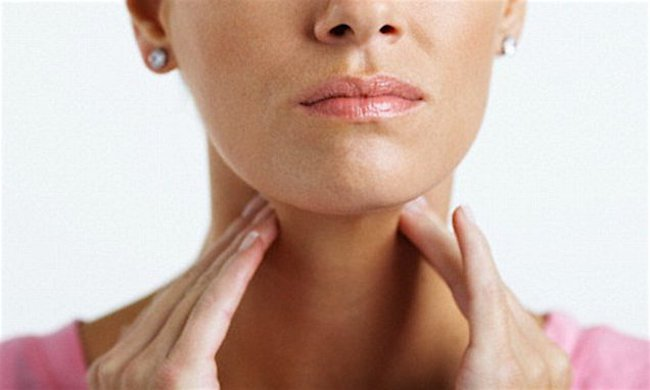 Woman With Sore Throat --- Image by © Sean Justice/Corbis