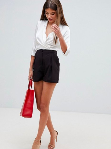 You can certainly wear them in the summer, but I have a pair that looks a lot like these and I wear them all year long with fishnet or opaque tights! You can tuck pretty much any top — from a tee to a dressy blouse — into them and it'll look fab.Get them from Asos for (available in sizes 0-14).