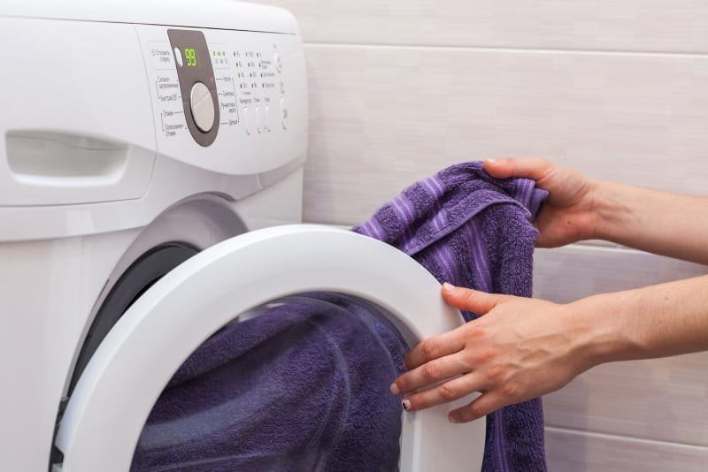 After about 15 minutes tumbling together, the towel will have soaked up a bunch of water from your clothes. Just take it out and hang it up to dry, and let the clothes finish drying faster than they would have otherwise. From here.