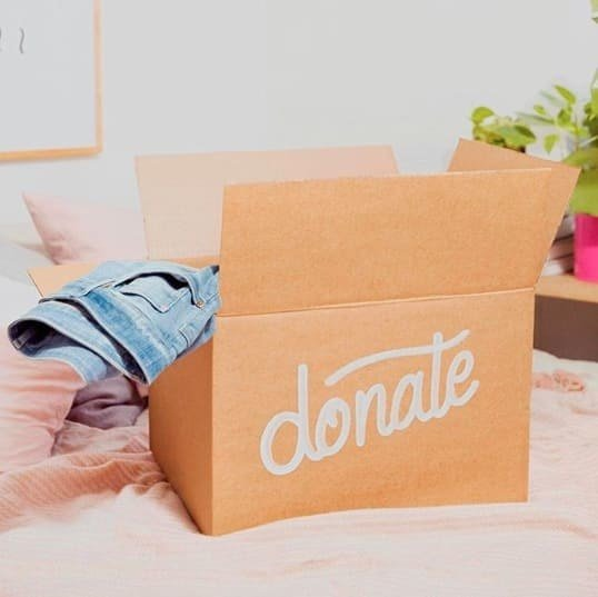You probably have a local Goodwill, Salvation Army, or other thrift store happy to take your clothing donations. You can also pack clothes and other items to donate then mail them (for free!) in an Amazon box: read more about the program at Give Back Box, and print your free shipping labels. (Same goes with lots of places where you online shop, including Loft, REI, and many others.)Something too torn up to donate? Your local H&M probably accepts clothes of any brand for donation (and might give you a 15% coupon in return); Madewell will accept jeans and give you a  off a new pair; and of course Goodwill, The Salvation Army, or other thrift stores generally recycle what they can't resell.