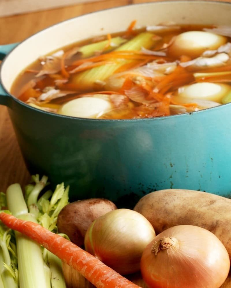 Collect onion skins and ends; carrot shavings, celery tops and bottoms; garlic tops, bottoms and skins; and more in your freezer, then when you have enough of everything, dump it in a pot with some water, and watch it simmer its way into stock in just half an hour. Here's Tasty's veggie stock recipe.