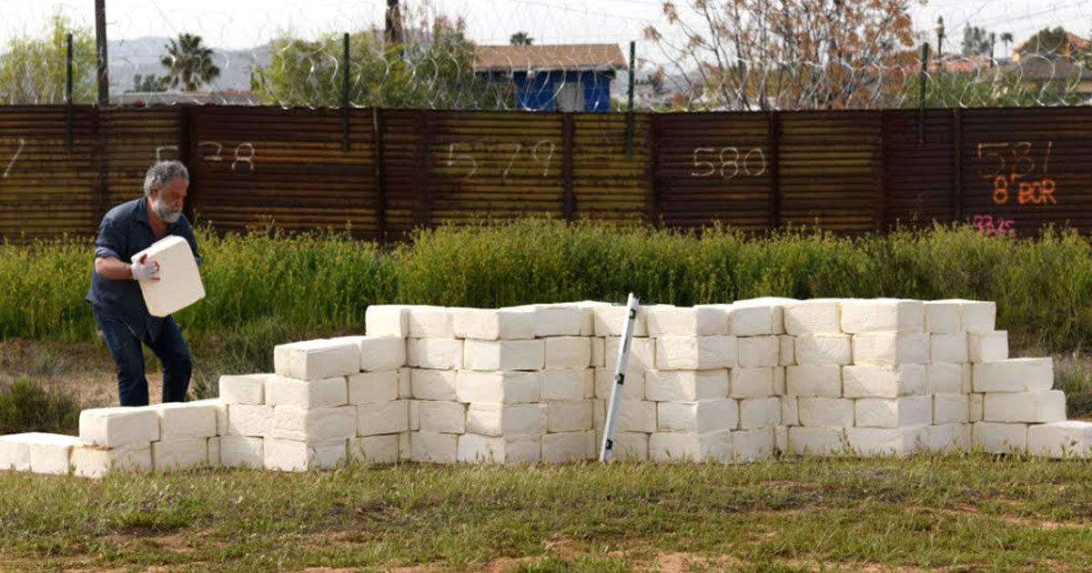 artist building a wall of cheese at us mexico border to make america grate again.jpg?resize=412,232 - Artist Building A Wall Of Cheese At US-Mexico Border To 'Make America Grate Again'