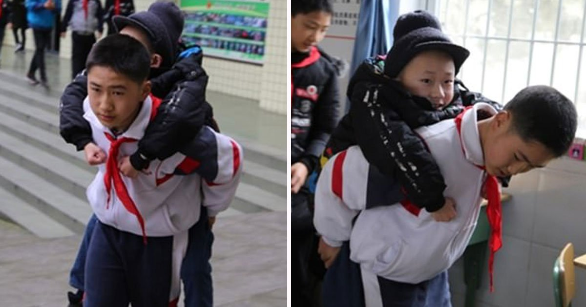 boy carries disable friend school.jpg?resize=412,232 - 12-Year-Old Boy Has Been Carrying His Disabled Best Friend To School For Six Years - 'If I Didn't Help Him, Nobody Else Would' He Said