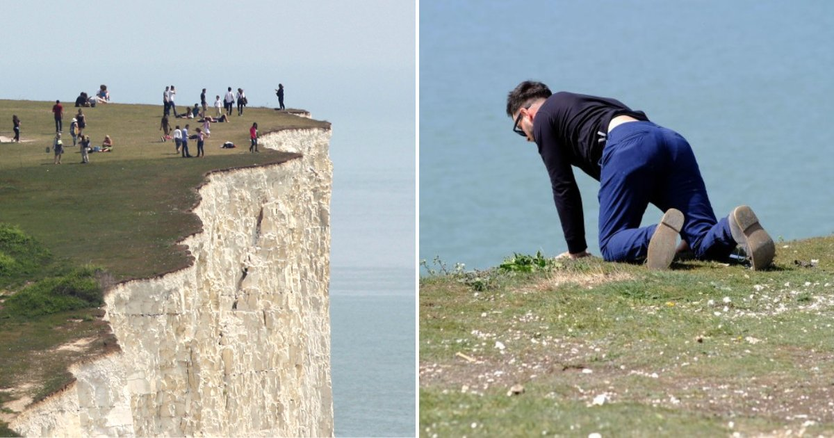 Un p re porte son enfant plus de 120 m tre de hauteur au bord d 39 une falaise extr mement - Hauteur d une porte ...