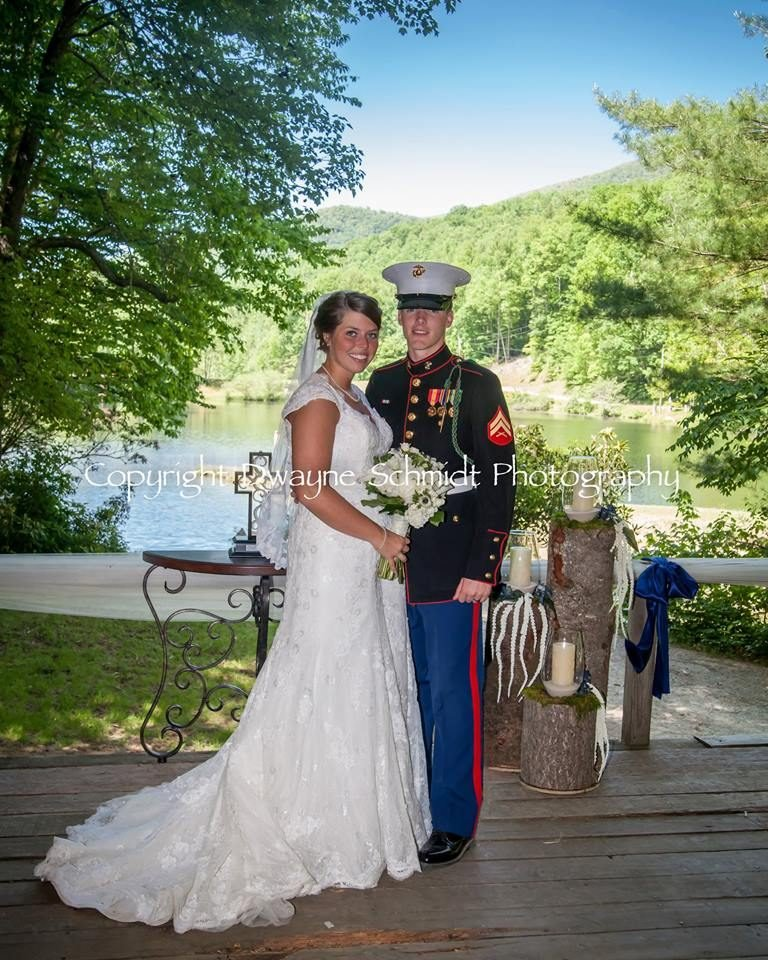 Image may contain: 2 people, people smiling, wedding, tree, outdoor and nature