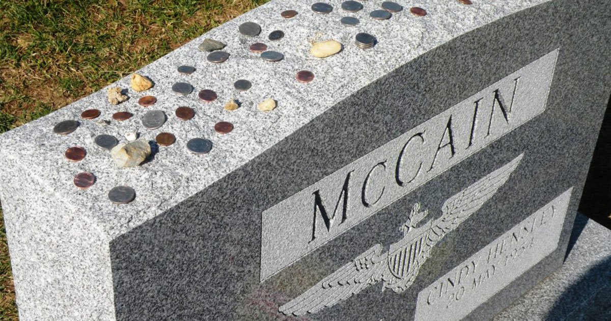 the meaning behind coins lying on military tombstones.jpg?resize=412,232 - Why You See Coins Lying On Military Tombstones