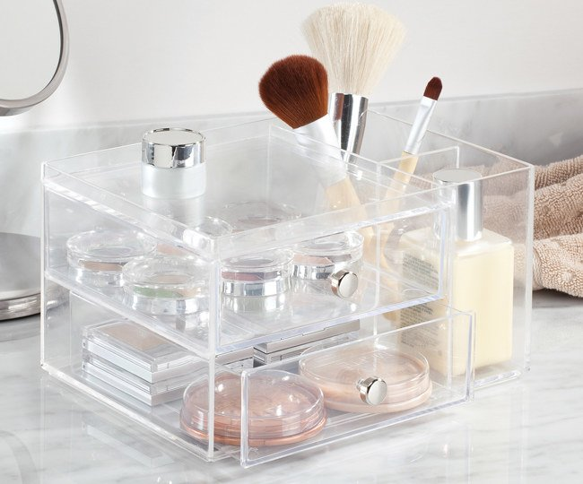 "Promising review: ""I bought this product to help me organize my makeup, and it works great! The side compartments are great for standing up brushes, mascara, etc., and the overall clear look helps you to see where everything is. The drawers are roomy and can fit several things. So far I love my purchase!"" —Haley