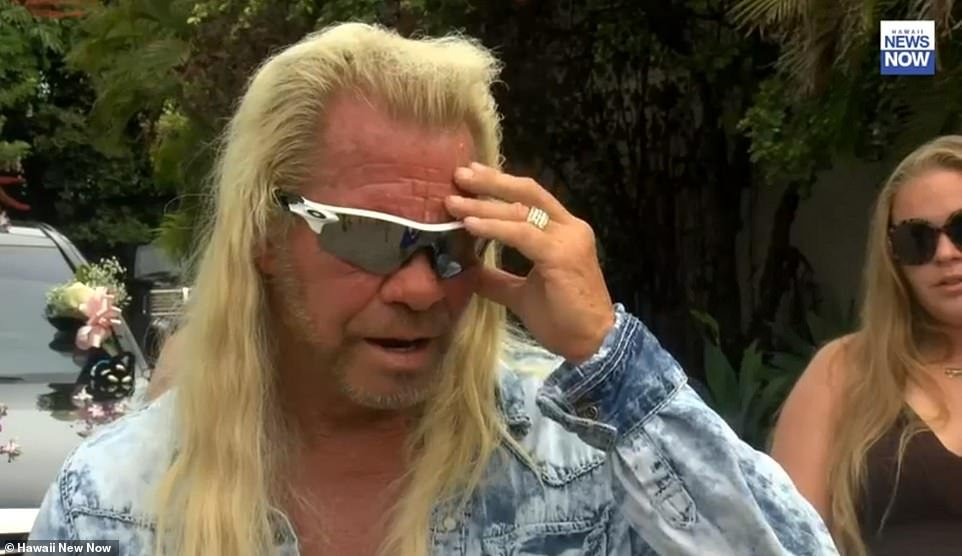 Dog the Bounty Hunter broke down outside his home in Hawaii on Wednesday afternoon as he described holding his wife Beth: