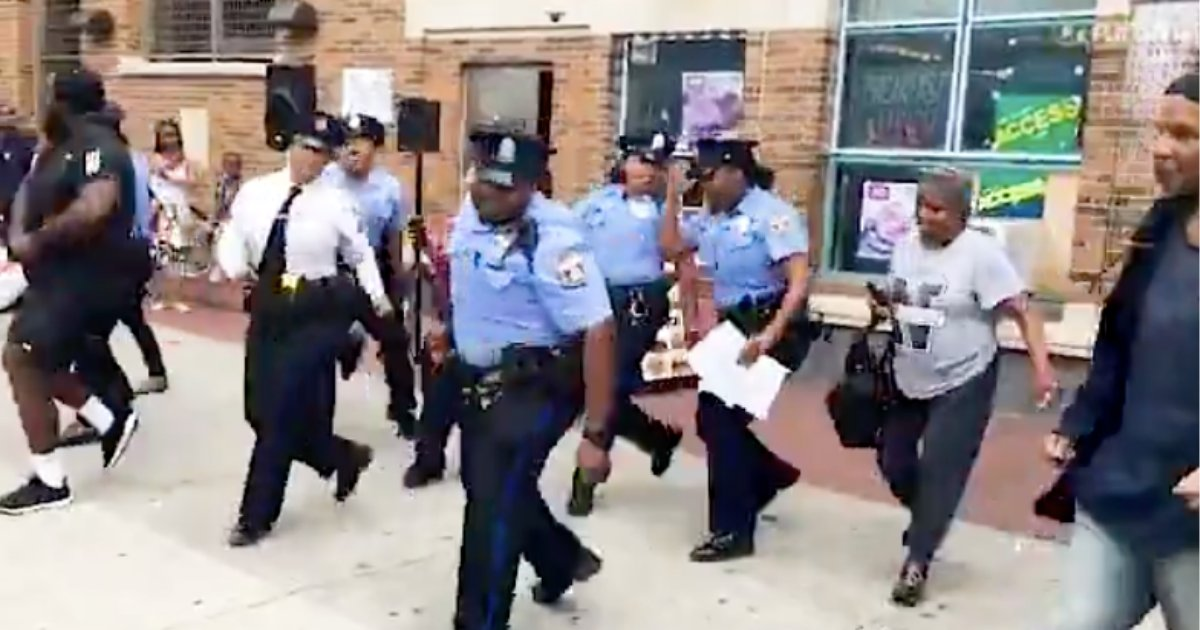 d2 17.png?resize=1200,630 - The Police Officers are Seen Dancing to The Electric Slide