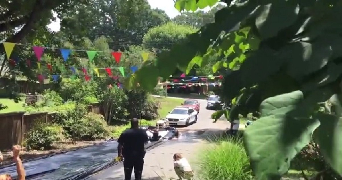 p3 3.jpg?resize=412,232 - Police Were Called To Shut Down A Neighborhood Slip'N Slide - They Joined The Fun Instead