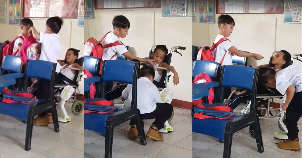 teacher captured heartwarming moment of two filipino students feeding their disable classmate.jpg?resize=412,232 - Teacher Captured A Heartwarming Moment Of Two Students Helping Out Their Disabled Classmate