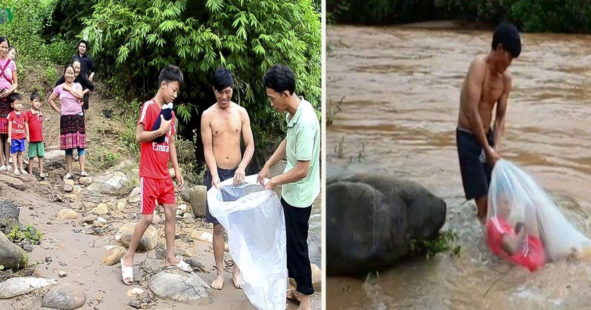 untitled 1 65.jpg?resize=300,169 - Des enfants d'un village vietnamien doivent traverser une rivière dans un sac en plastique pour se rendre à l'école