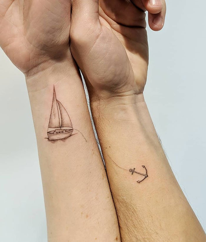 Some Sailing Tattoos For This Couple. Good Luck On Your Adventures