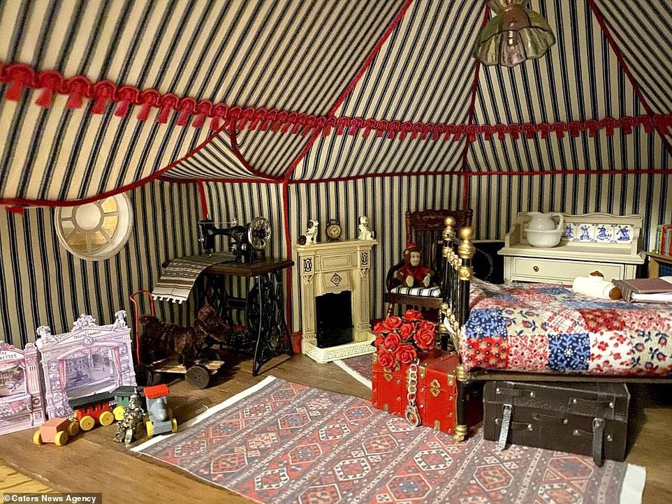 The 42-year-old has so far built eight rooms as part of the project which he has named Hordle Castle including a lavish attic room (pictured) that was inspired by the nursery at Kingston Lacy in Dorset. It includes its own Dutch cabinet doll