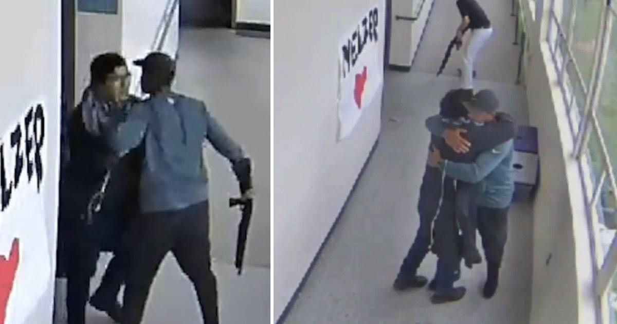 a 79.jpg?resize=412,232 - Emotional Moment A Football Coach Hugged An Armed High School Student