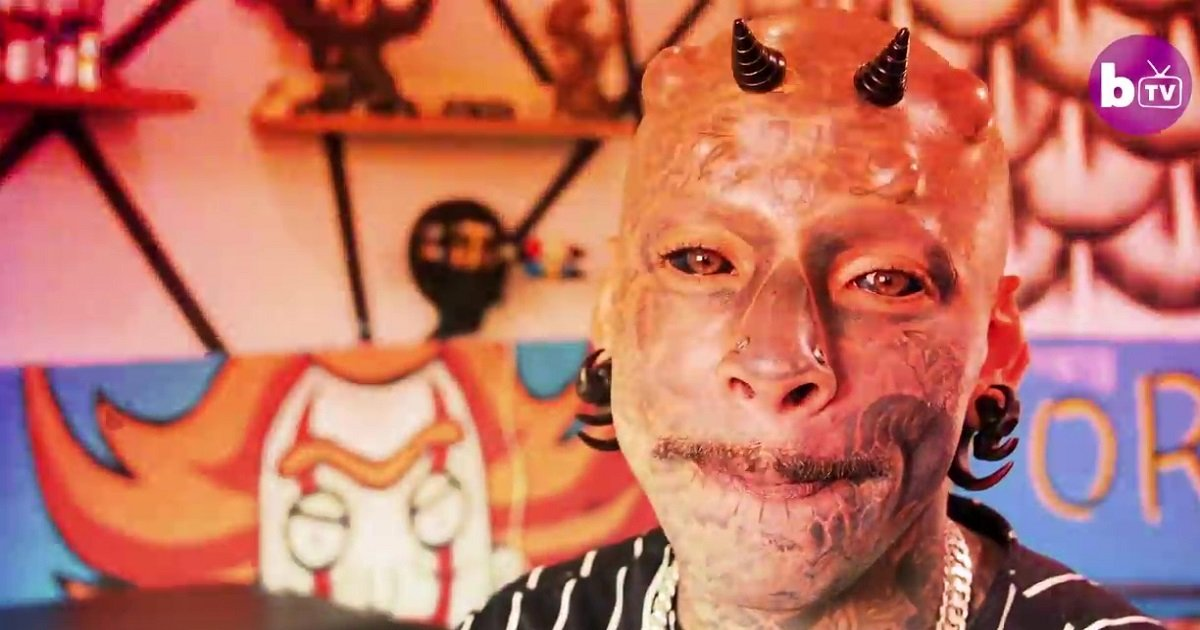 t3 6.jpg?resize=412,232 - Young Dad Who's A Body Mod Fan Had 60% Of His Body Tattooed And Even Has Screw-On Horns
