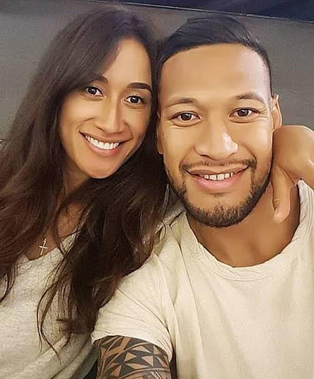 Folau (pictured with with Maria) told worshippers God was speaking to Australia and said: