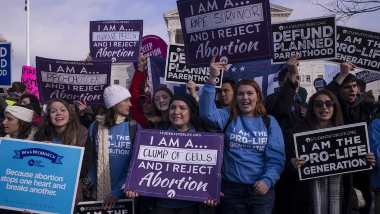 Pro-life demonstrators hold signs outside of the U.S. Supreme Court during the 46th annual March for Life in Washington, D.C., U.S., on Jan. 18, 2019.