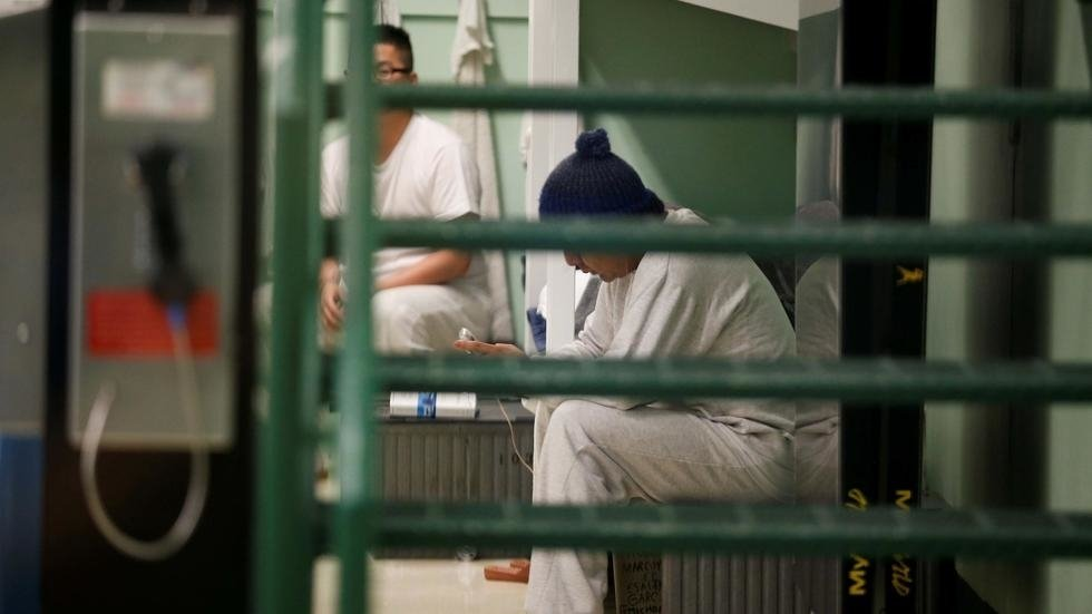 (File photo) Detainees sit on their bunks in a housing unit during a media tour at Northwest ICE Processing Center, one of 31 dedicated ICE facilities that house immigration detainees, in Tacoma, Washington, U.S. December 16, 2019.