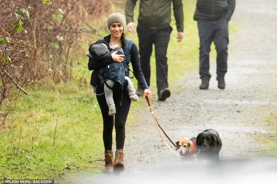 She wrapped up in layers under a green beanie hat, wearing black leggings and her favourite Kamik ankle-high brown hiking boots