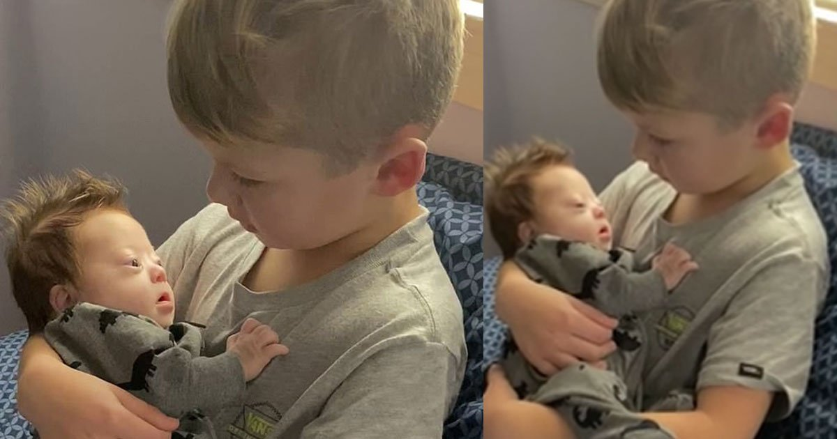 six year old boy cradles his baby brother born with downs syndrome and sings a song for him.jpg?resize=300,169 - Six-Year-Old Boy Cradled His Baby Brother Born With Down's Syndrome And Sang A Song For Him
