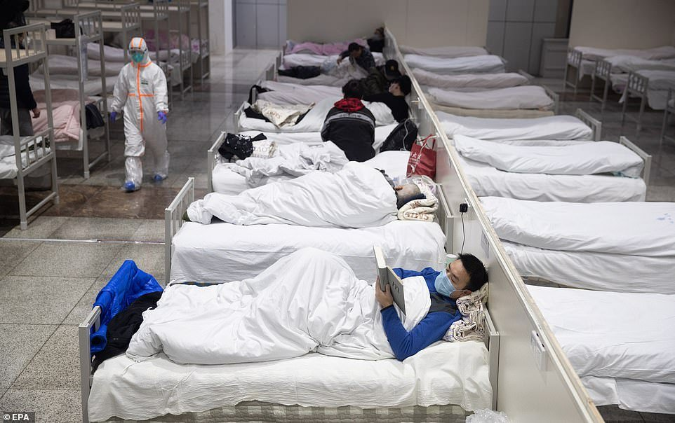 China has demanded four types of people in Wuhan to be put into mandatory isolation in quarantine stations: confirmed cases, suspected cases, people who have close contact with the former two, and those who have fever. Pictured, patients rest at a makeshift hospital