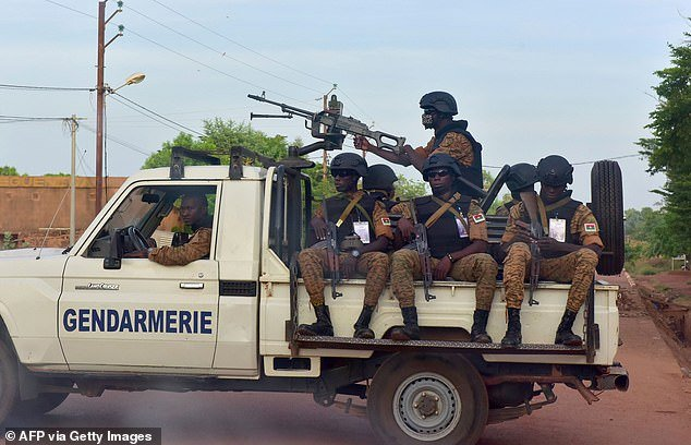 A picture taken on October 30, 2018 shows Burkinabe gendarmes sitting on their vehicle in the city of Ouhigouya in the north of the country