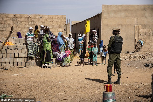 A Burkina Faso soldier patrols at a district that welcomes Internally Displaced People (IDP) from northern Burkina Faso, in Dori on February 3, 2020