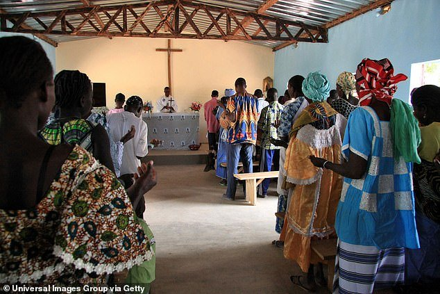 A 2008 file photo shows a congregation worshipping at a church in the district of Toleha in Burkina Faso