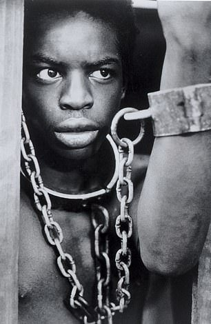 A picture from 1977 shows Levar Burton playing Kunta Kinte in the miniseries