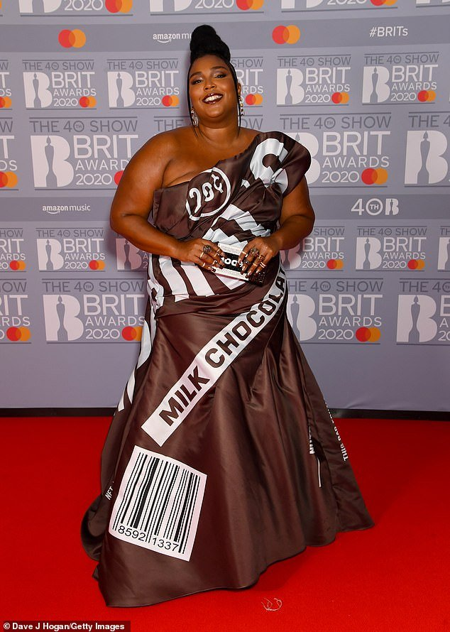 Showstopper:Lizzo was a sight to behold as she arrived on the red carpet in a chocolate themed gown at the BRIT Awards at The 02 Arena in London on Tuesday