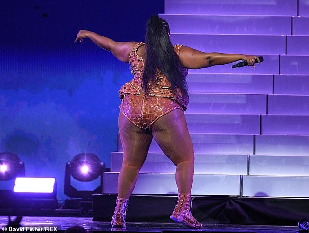 Confident: Lizzo paraded her curves in the skintight one-piece