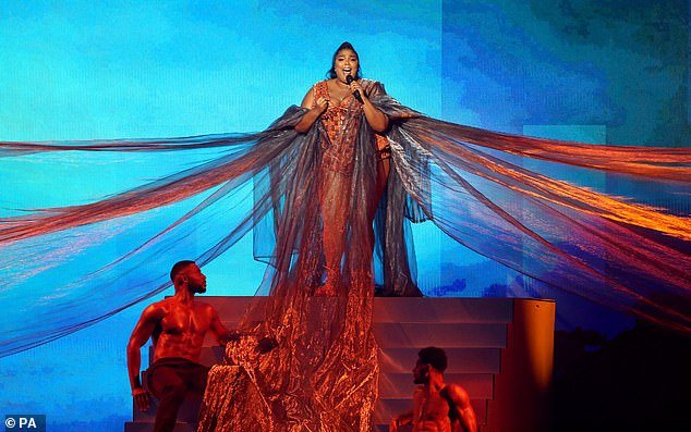 Stage presence: The star started her performance in a dramatic cape which was held up by backing dancers