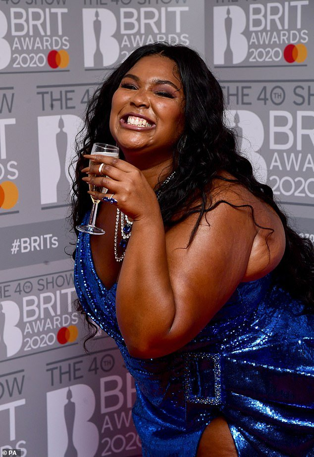 Bubbly: Lizzo quaffed on champagne after storming the stage
