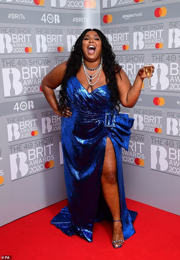 Stunning: Lizzo looked incredible as she made a quick change in a blue sequin dress