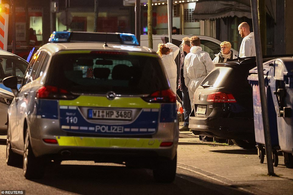 Forensic experts outside a shisha bar after a shooting in Hanau near Frankfurt. Eight people were killed in both attacks