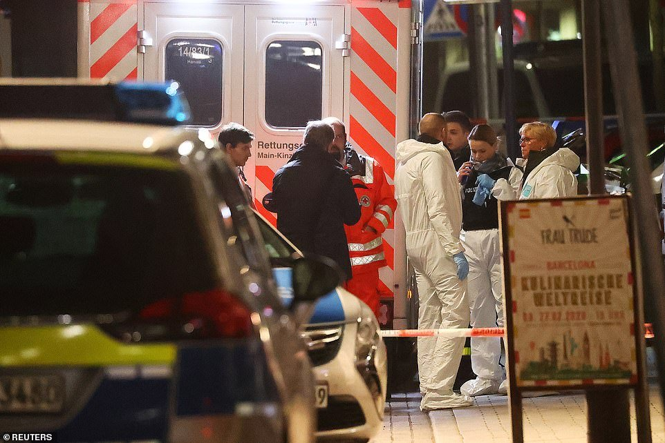 Forensic experts are seen outside a shisha bar after a shooting in Hanau near Frankfurt