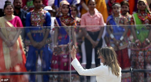 Melania Trump waves to the crowd when she appeared at President Trump