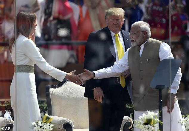 Melania shakes hands with Prime Minister Modi during an event atSardar Patel Stadium where he praised her work with children as part of her