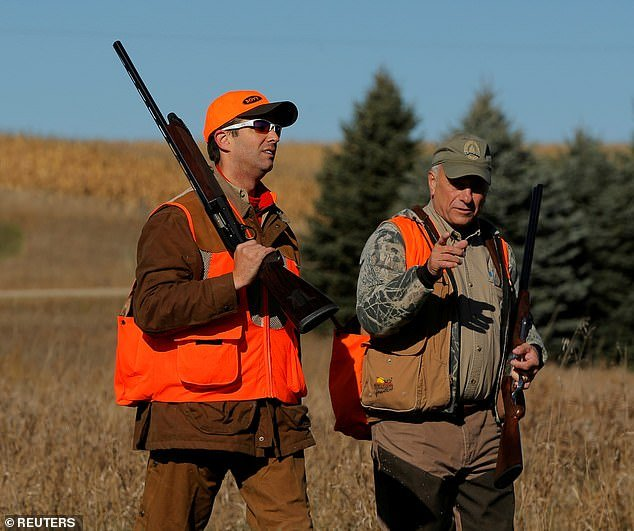 Donald Trump Jr. is pictured with Rep. Steve King after the Colonel Bud Day memorial pheasant hunt near Akron, Iowa, in October 2017
