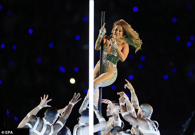 Sexy squad: Dancers flanked JLo as she commanded attention from the pole