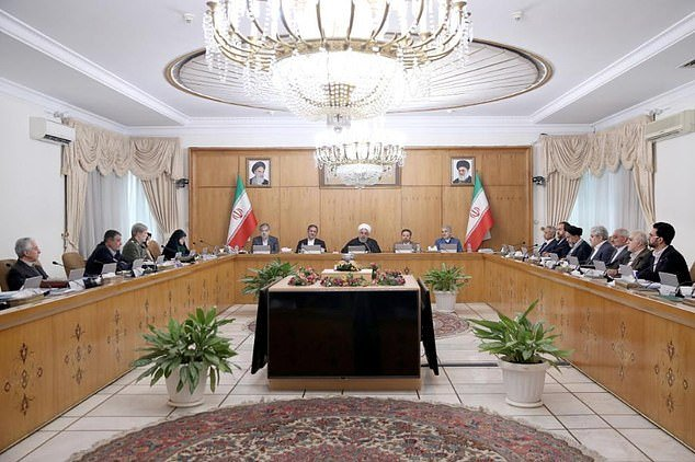 Masoumeh Ebtekar (top left) was at a cabinet meeting of Iranian politicians yesterday, where she sat just a few seats away from President Hassan Rouhani