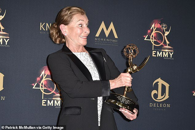 Feted: Judge Judy posed with a Daytime EmmysLifetime Achievement Award she received last May in LA