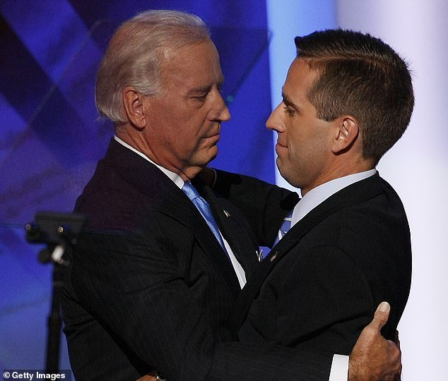 Joe Biden said Buttigieg reminded him of his son Beau, who died in 2015; the two Bidens are seen embracing at the 2008 Democratic National Convention in November when Joe Biden was nominated to be vice presidentf