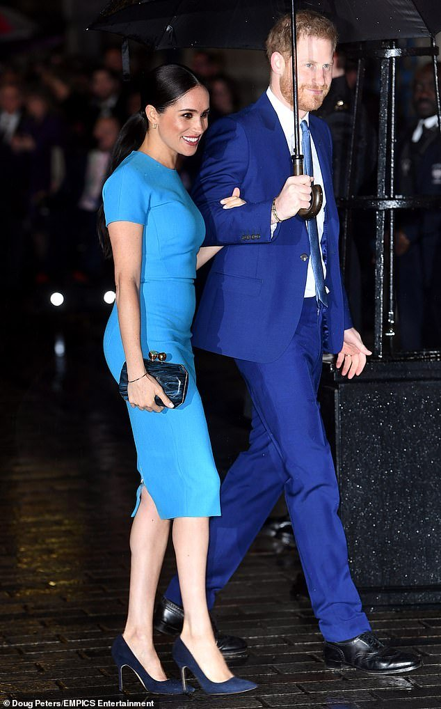 The Duchess of Sussex, 38, was praised by fans tonight as she made her first appearance since announcing her plan to step back from life as a senior royal (pictured with Prince Harry)