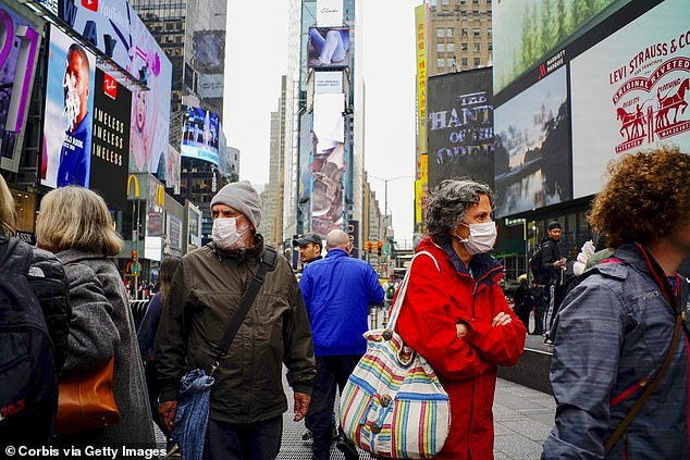 US hospitals are preparing for 96 million coronavirus infections and nearly half a million deaths from the outbreak, leaked documents have revealed. People are pictured wearing face masks in Times Square, New York on March 3