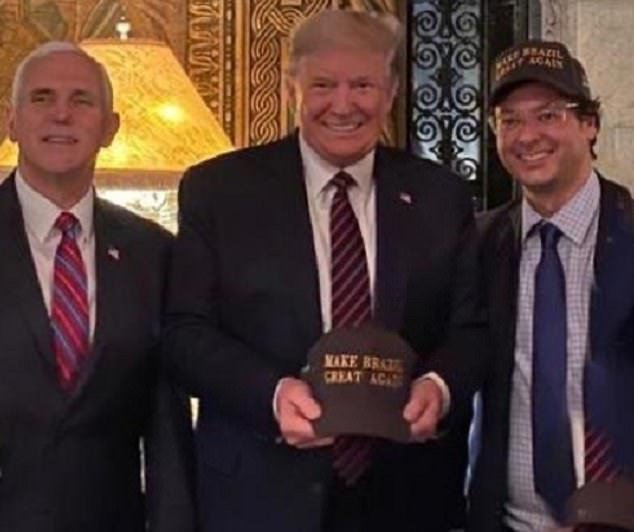 From left: Vice President Mike Pence, President Donald Trump, andFabio Wajngarten, the communications secretary for Brazilian President Jair Bolsonaro. The three men posed for a photo on Saturday at Trump