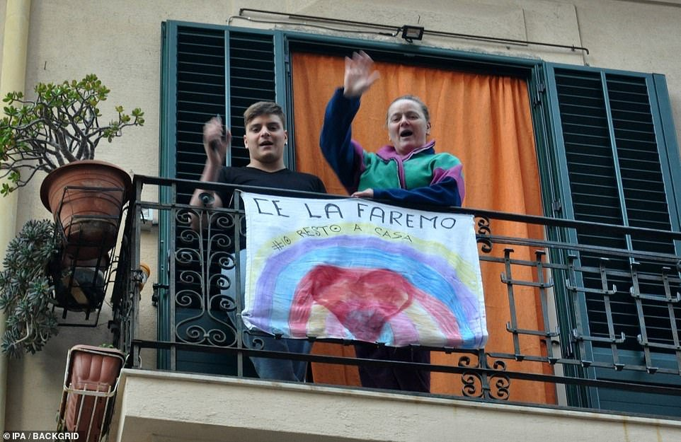 People singing from their balcony in Palermo during the lockdown in Italy, which is starting to show signs of bearing fruit